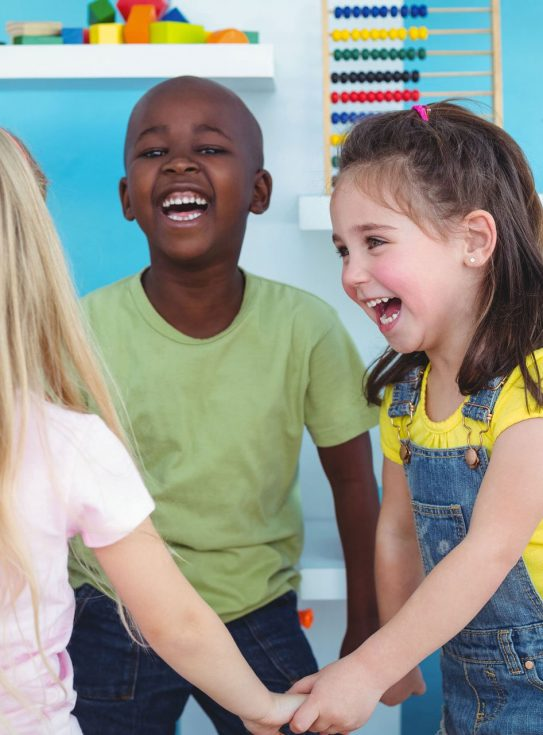 children laughing at childcare center